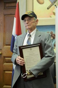 Leonard Crowl poses with his award at the Missouri Capitol.