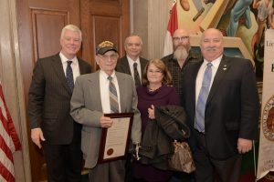 From left, Lt. Gov. Peter Kinder, World War II Veteran Leonard Crowl, his son and daughter-in-law Wayne and Joyce Crowl, Odessa Senior Center Coordinator Brian Hennings, and State Rep. Glen Kolkmeyer, of Lafayette County